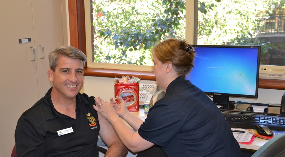 CEO Nathan Klinge receiving his Flu vaccination